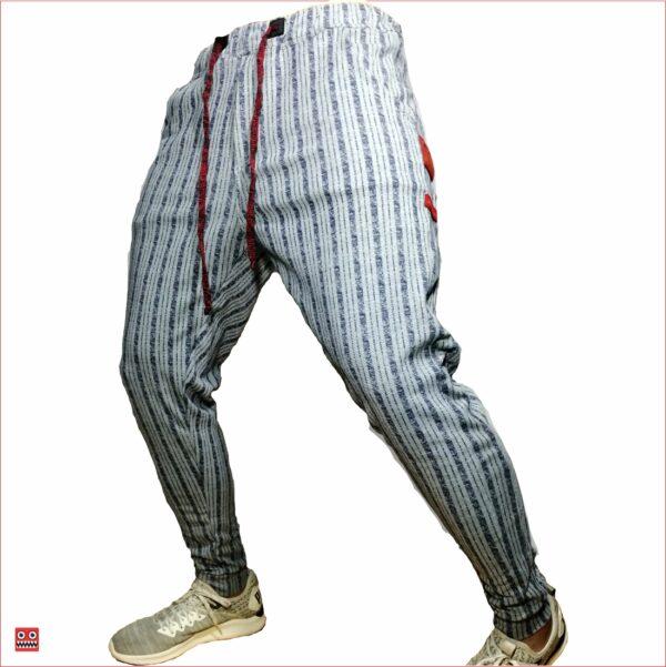 Sudadera ref 1407 00 DESCRIPCION Sudadera jogger color gris con rayas, tela 98% algodon mas 2% de expande. $67 mil