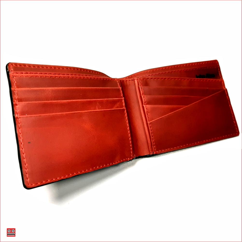 Billetera negro perforado con interior rojo, material 100% cuero, $45.000 1
