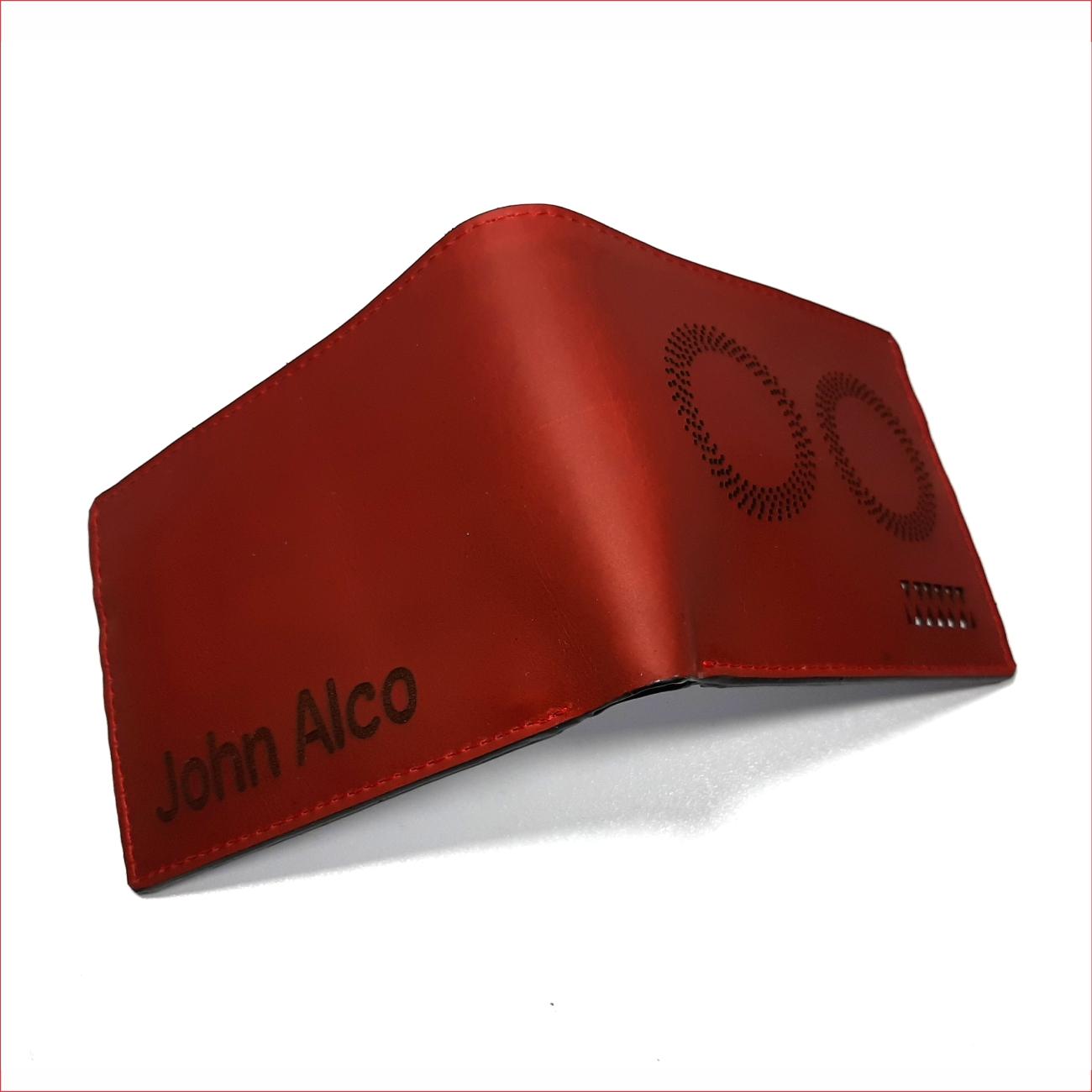 Billetera rojo perforado con interior blanco, material 100% cuero, $40.000 2