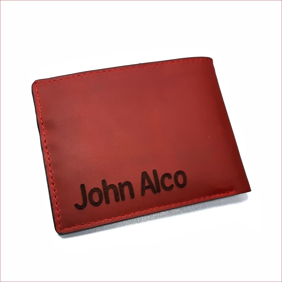 Billetera rojo perforado con interior blanco, material 100% cuero, $40.000 3